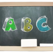 Blackboard with sketchy colorful ABC written on it isolated — Stock Photo #44294387