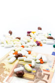 Pile of pills and banknotes closeup with copy-space — Stock Photo