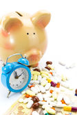 Piggy bank with pile of pills, banknotes and clock isolated — Stock Photo