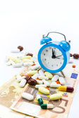 Pile of pills with banknotes and clock isolated with copy-space — Stock Photo