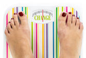 "Feet on bathroom scale with word ""Change"" on dial — Stock Photo"