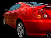 Roter sportwagen über schwarz — Stockfoto