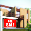 """Home For Sale"" sign in front of new house. — Стоковое фото"