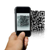 Mobile phone scanning a tridimensional barcode — Stock Photo