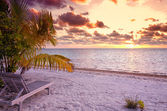 Empty beach chair in the tropical beach in the Maldives at sunset — Stock Photo