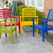 Colorful wooden chairs on various background — Stock Photo