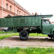 Vintage Russian military vehicle on green gras — Stock Photo