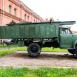 Vintage Russian military vehicle on green gras - Stock Photo