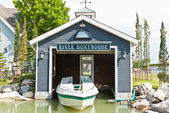 Fisherman's house and boats in a bay. — Stock Photo