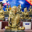 Stock Photo: Thai multiple golden monks statue