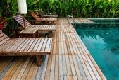 Small swimming pool with wooden setting surrounded by trees — Stock Photo