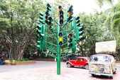 Multiple large traffic lights post made from green metal — Stock Photo