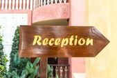 Wooden polished arrow reception sign — Stock Photo