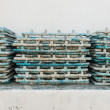 Very dirty blue PVC pipe stack together - Stock Photo