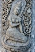 Ancient old vintage buddha sculpture on the wall — Stock Photo