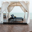 Stock Photo: Beach front dual leather relax chairs inside tent facing s