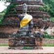 Ancient buddha partly damage — Stock Photo