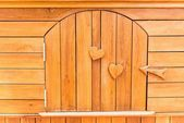Wooden texture with love sign and symbol embedded — Stock Photo