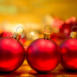 Red Christmas balls on a gold background — Stock Photo #16368789