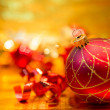 Red Christmas balls on a gold background — Foto de Stock