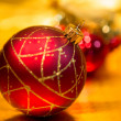 Red Christmas balls on a gold background — Stockfoto