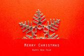 Vintage Christmas postcard with snowflakes — Stock Photo