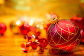 Red Christmas balls on a gold background — Stock Photo