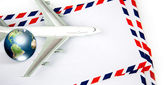 Airmail envelope with model airplane and earth (Elements of this — Stock Photo