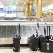 Stock Photo: Suitcases and luggage band on airport
