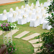 Wedding ceremony in beautiful garden — Stock Photo #18737095