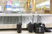 Suitcases and luggage band on the airport — Stock Photo
