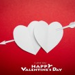 Two paper hearts pierced with an arrow symbol for Valentines day — Stock Photo #19144659