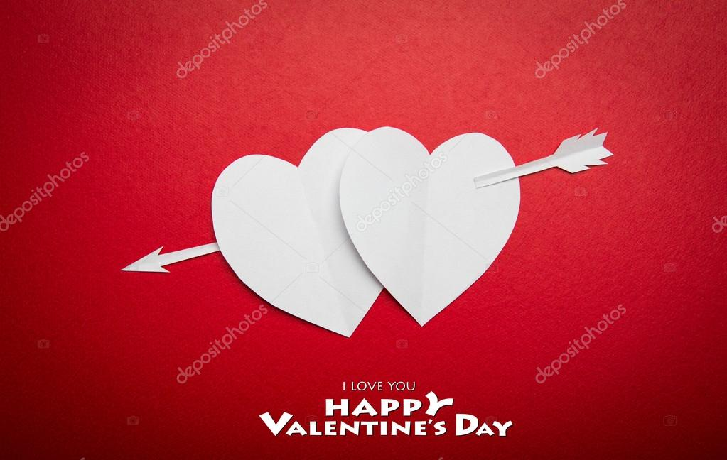 Two paper hearts pierced with an arrow symbol for Valentines day  with copy space for text or design  Stock Photo #19144659
