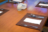 Table appointments- fork,knife,spoon, silk napkin — Stock Photo