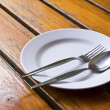 Closeup of plate on old white wood table - Stock Photo