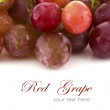 Stock Photo: Close up of red grapes on white background with copy space.
