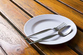 Closeup of plate on old white wood table — Stock Photo