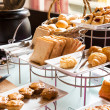 Assortment of fresh pastry on table in buffet — Stock Photo
