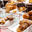 Assortment of fresh pastry on table in buffet — Stock Photo #20784667