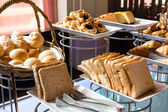 Assortment of fresh pastry on table in buffet — Stok fotoğraf