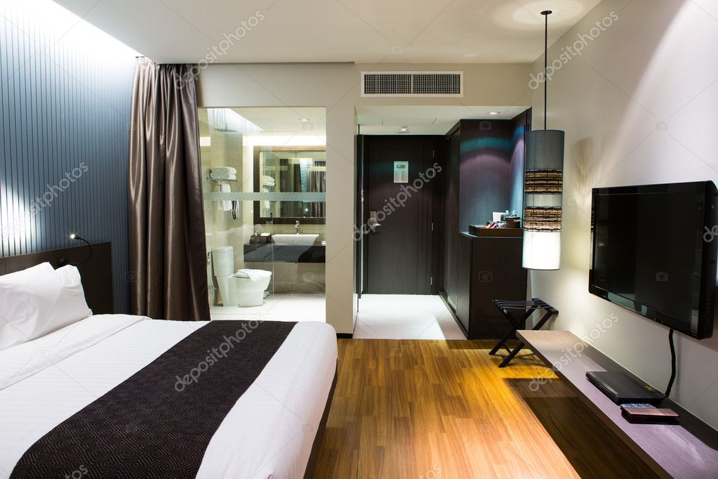 Interior of modern comfortable hotel room stock photo for Modern hotel
