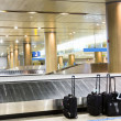 Suitcases at airport interior at baggage claim — Stock Photo