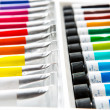 Colorful acrylic paints in tubes — Stock Photo #21760595