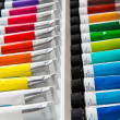 Colorful acrylic paints in tubes — Stock Photo