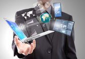 Businessman with laptop,mobile phone,touch screen device — Stock Photo