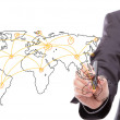Businessman drawing a world map isolated on a white background — Foto Stock