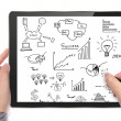Businessman hand drawing graph on touch screen tablet — Stock Photo #24067639