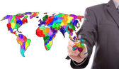 Businessman drawing colorful map of world — Stock Photo