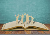 Paper cut family symbol on old book — Stock Photo