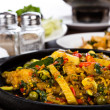 Fried fish with fresh herbs and  spicy sauce served on iron hot — Stock fotografie